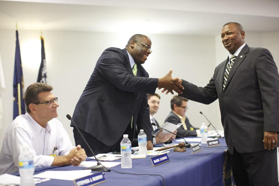 Tito Jackson shook hands with Suffolk County Sheriff Steven W. Tompkins in 2015.